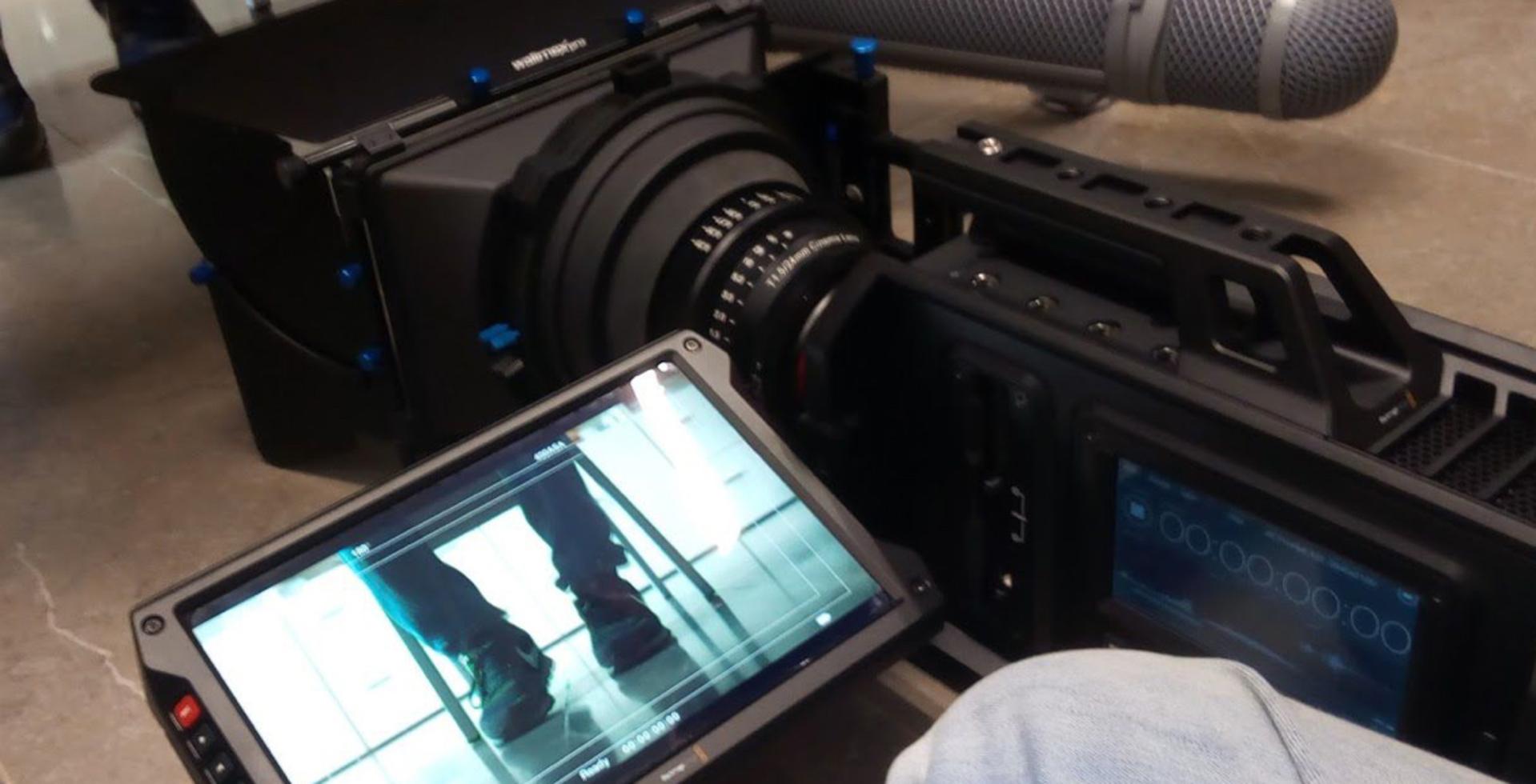 image of a camera recording a scene
